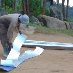 The Water Project: Musasa Primary School -  Preparing Metal Latrine Roof