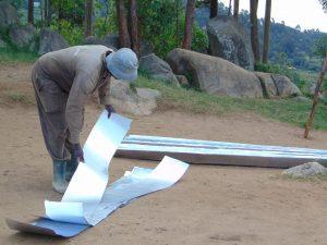 The Water Project:  Preparing Metal Latrine Roof