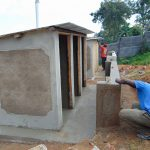 The Water Project: Goibei Primary School -  Latrines Receiving Plaster