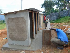 The Water Project:  Latrines Receiving Plaster