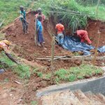 The Water Project: Shamakhokho Community, Imbai Spring -  Adding Plastic Tarp Over Backfilled Area