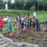 The Water Project: Emmachembe Community, Magina Spring -  Grass Planting