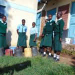 The Water Project: Friends Kuvasali Secondary School -  Students Collecting Water Patiently