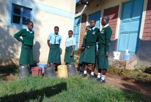 The Water Project:  Students Collecting Water Patiently