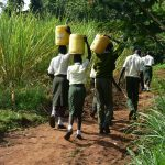 The Water Project: ACK St. Peter's Khabakaya Secondary School -  Students Carrying Water