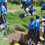 The Water Project: Malinda Secondary School -  Students Collecting Water