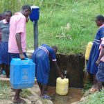 The Water Project: Kapkoi Primary School -  Students Fetching Water