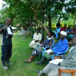 The Water Project: Bung'onye Community, Shilangu Spring -  Community Member Using Training Materials