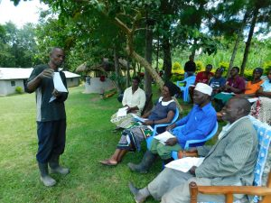 The Water Project:  Community Member Using Training Materials