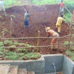 The Water Project: Shamakhokho Community, Imbai Spring -  Leveling Backfilled Area