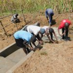 The Water Project: Sichinji Community, Kubai Spring -  Community Participates In Grass Planting