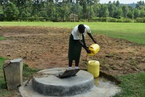 The Water Project:  Student Pulling Water From The Well