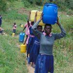 The Water Project: Kapkoi Primary School -  Students Carrying Water