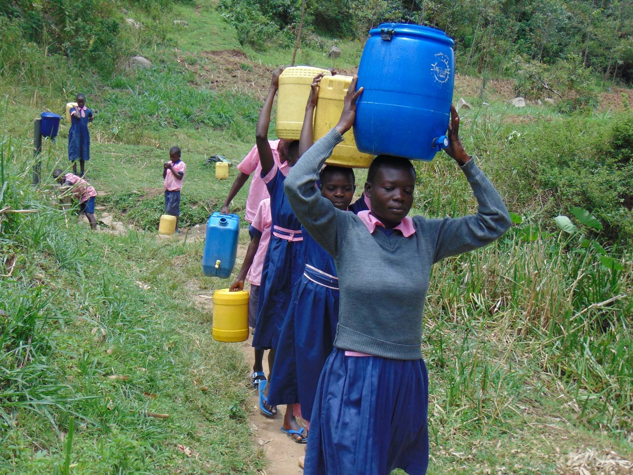 The Water Project : 23-kenya20117-students-carrying-water-5
