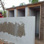 The Water Project: Mukangu Primary School -  Plastering The Latrines