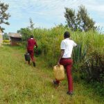 The Water Project: Friends School Ikoli Secondary -  Students Carrying Water