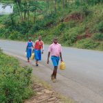 The Water Project: Kapsaoi Primary School -  Students Carrying Water