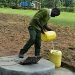 The Water Project: ACK St. Peter's Khabakaya Secondary School -  Student Pulling Water From The Well