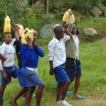 The Water Project: Mutiva Primary School -  Students Carrying Water