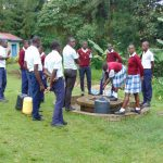 The Water Project: Friends Secondary School Shirugu -  Student Collecting Water