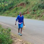 The Water Project: Kapsaoi Primary School -  Student Carrying Water