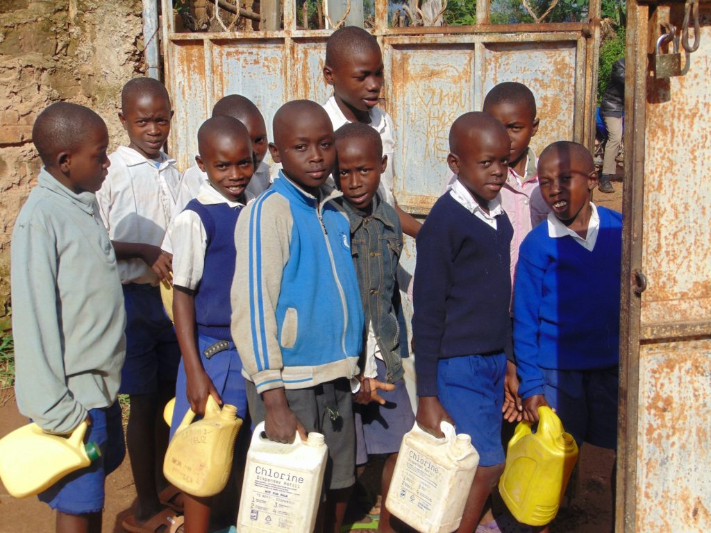 The Water Project : 25-kenya20108-students-with-water-containers-at-the-school-gate