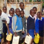 The Water Project: Mutiva Primary School -  Students With Water Containers At The School Gate