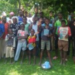 The Water Project: Chegulo Community, Sembeya Spring -  Paticipants With Training Materials And Trainer Betty