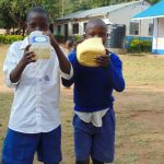 The Water Project: Mutiva Primary School -  Students Drinking Water From The Spring