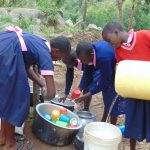 The Water Project: Kapkoi Primary School -  Students Washing Dishes