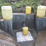 The Water Project: Chegulo Community, Sembeya Spring -  Clean Water Flowing From Sembeya Spring