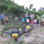 The Water Project: Chegulo Community, Sembeya Spring -  Planting Grass During Training