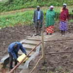 The Water Project: Emmachembe Community, Magina Spring -  Cleaning Demonstration