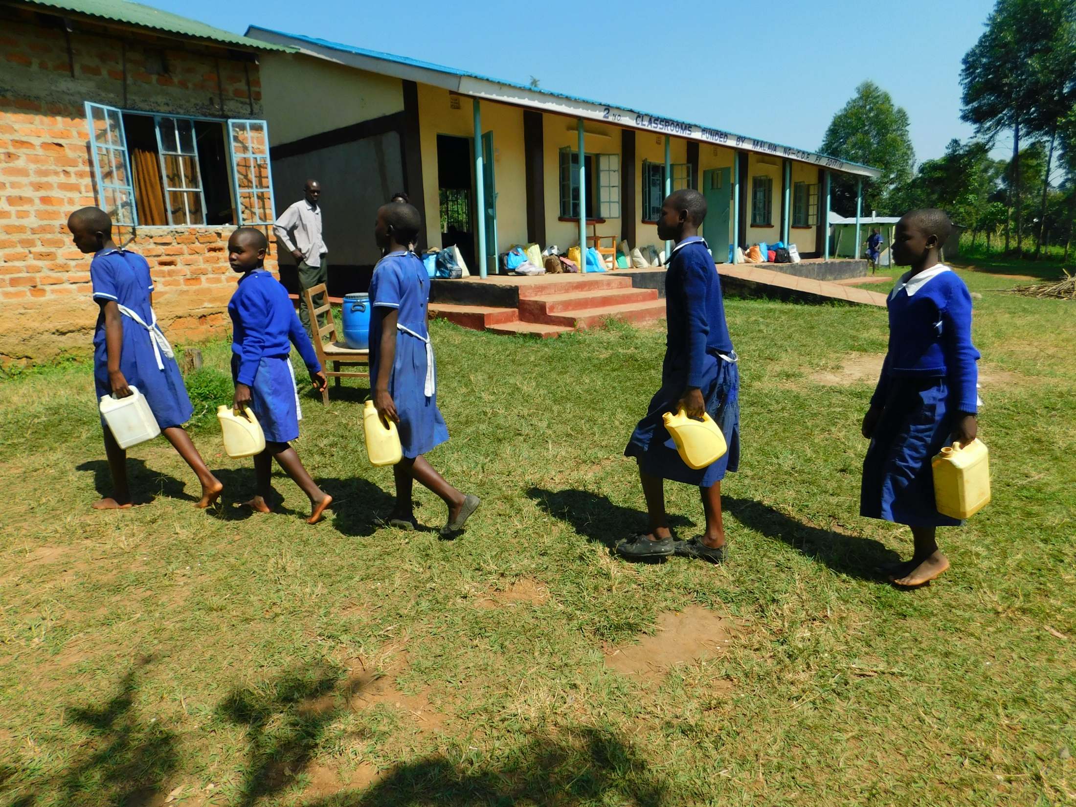 The Water Project : 27-kenya20105-students-carrying-water-3