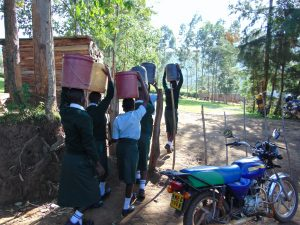 The Water Project:  Students Carrying Water Through The School Gate
