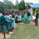 The Water Project: Mukangu Primary School -  Student Leads Handwashing Practice