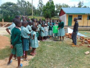 The Water Project:  Student Leads Handwashing Practice