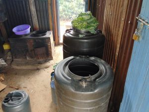 The Water Project:  Water Storage Drums In The Kitchen