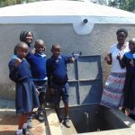 The Water Project: Enyapora Primary School -  Studens And Staff Celebrate The Rain Tank
