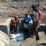 The Water Project: Chegulo Community, Sembeya Spring -  Children Celebrating The Water