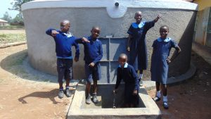 The Water Project:  Students Pose With Rain Tank