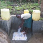 The Water Project: Chegulo Community, Sembeya Spring -  Enjoying The Spring Water