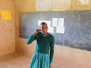 The Water Project:  Student Demonstrates Toothbrushing