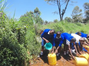 The Water Project:  Students Collecting Stream Water