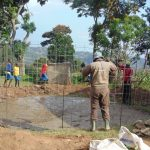 The Water Project: Musasa Primary School -  Fitting The Rain Tank Wire Form