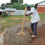 The Water Project: Goibei Primary School -  Adding Cement To The Rain Tank Foundation