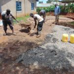 The Water Project: Womulalu Special School -  Mixing Conrete For Rain Tank Foundation