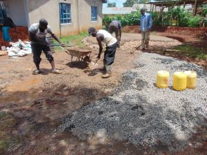 The Water Project:  Mixing Conrete For Rain Tank Foundation