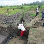 The Water Project: Chegulo Community, Sembeya Spring -  Laying The Foundation