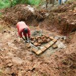 The Water Project: Mushina Community, Shikuku Spring -  Brick Laying Begins